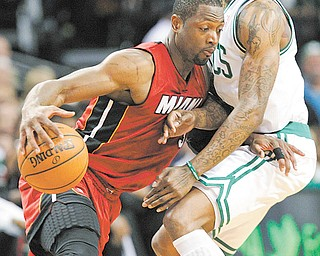 The Miami Heat's Dwyane Wade drives against the Boston Celtics Marquis Daniels during Game 6 of the NBA Eastern Conference finals Thursday In Boston. The Heat defeated the Celtics, 98-79, to tie the series 3-3 and force Game 7.