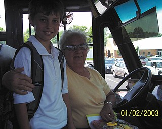 Student council members at Holy Family School in Poland organize an annual Bus Driver Appreciation Day. They bake cookies, make cards and give carnations, always taking the bus drivers by surprise. Third-grade student Thomas Fire is shown with Claire Deemer, driver of Bus 19. Student council advisers are Renee Abbattista and Lissa Oslin.