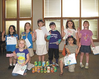 Daisy Girl Scout Troop 80777 of Columbiana has nine girls who recently completed their first year of Girl Scouting. Their activities have included the annual cookie sale and a canned food collection, along with various craft projects each month when they meet. They have earned several patches over the year. The next project will have the girls planting flowers at Joshua Dixon Elementary School, where they all attend. The Girl Scouts are participating in early bird enrollment for the session that begins in the fall. Girls going into first grade this fall can call Crystal Boggs at 330-482-9105 to sign up. Here, the girls are showing their earned patches and incentives from the cookie sale. Some of the 33 pounds of canned food they collected, which was donated to the Way  Station in Columbiana, also is displayed. In the front row, from left, are Rebekah Clark and Chloe Gill. In the back row are Mia Surenavic, Elizabeth Siembida, Airianna  Scullion, Alaina Johnston, Chloe Loveland and Katrina Kaszowski. Absent from the  picture is Abbie Passmore.