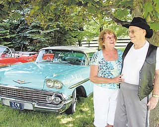 Fred and Rosemary Ross stand next to their 1958 Chevy Impala. The Hubbard couple drove a similar '58 Impala for their honeymoon and plan to drive this one to celebrate their 50th wedding anniversary in August.