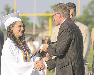 Madison Groner, one of the top 10 students in the 2012 Springfield Local High School Class of 2012, receives her diploma Sunday at the school's commencement.