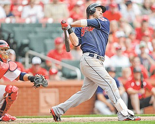 St. Louis Cardinals catcher Yadier Molina watches as the Cleveland Indians' Jason Kipnis connects for a three-run homer in the ninth inning of Sunday's baseball game in St. Louis. The Indians beat the Cardinals 4-1.
