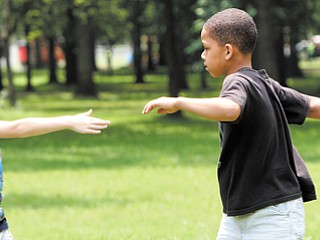 Nathan Wilson, 6, left, and Andrei Wilder, 7, play a game during summer camp in Roosevelt Park in Campbell. Tuesday was the first day of the camp, which is open to kids in kindergarten through sixth grade.