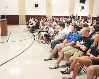 A crowd of more than 80 people at St. Christine School heard a committee of concerned parents' concerns about Austintown schools' proposal to off er public-transit vouchers to private-school students instead of using district vehicles.