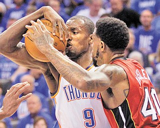 Thunder power forward Serge Ibaka (9) is defended by Heat power forward Udonis Haslem during Tuesday's Game 1 of the NBA Finals in Oklahoma City, Okla.
