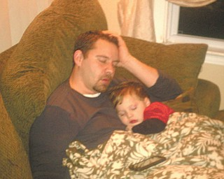 Randy Hovanec and his son Austyn rest after a tough day. They are from North Jackson. Photo submitted by Kelly Hovanec.