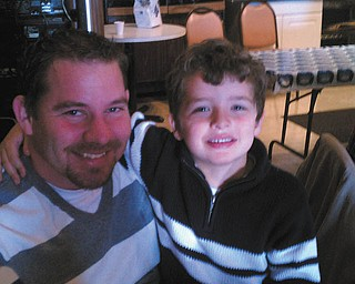 Randy Hovanec shares a moment with his son Dylan. Both are from North Jackson. Photo sent in by Kelly Hovanec.