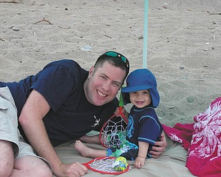 Nick and Nico Gentile of Salem enjoy Nico's first trip to the beach during the recent warm weather. Photo sent in by Andrea Gentile.