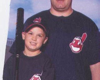 Joey Herubin and son Max, both of Canfield, show their Indians pride. Photo sent in by Bella Herubin.