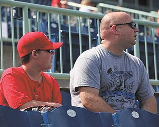 Tyler Platt and his dad, Mike Platt, both from Niles, share a love of baseball and the Scrappers.