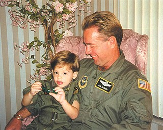 Col. Don F. Warrick of the Air Force Reserve holds his son, Crawford Warrick, who was 4 when this photo was taken. They are from Youngstown.