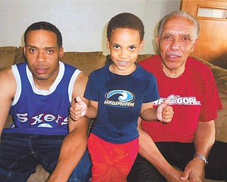Tariq H. Truman of Youngstown gives a proud thumbs-up to his father, David A. Truman of Youngstown, left, and his grandfather (whom he calls Papa), David M. Truman of Boardman. Photo sent in by David M. Truman.