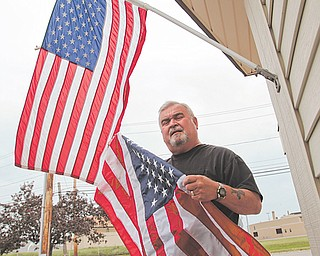Ron Craig, owner of Western Reserve Flag Co. on Stadium Drive, sells only American-made flags. Today is Flag Day.