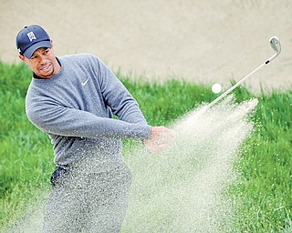 Tiger Woods hits out of a bunker on the second hole during a practice round for the U.S. Open Championship golf tournament Wednesday at The Olympic Club in San Francisco.