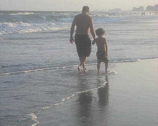 Tony Perry walks along the beach with his son Anthony. They live in Salem. Photo sent in by Allyson Perry.