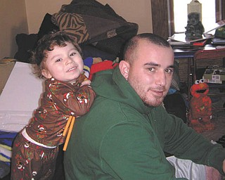 Rob Ginocchi was putting together the train Santa left for his son Pierson on Christmas morning 2011 when this picture was taken. They are from Girard. Photo sent in by Adriana Ginocchi.
