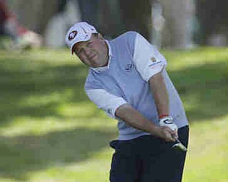 Dennis Miller hits out of the rough on the first hole during the first round of the U.S. Open Championship golf tournament Thursday, June 14, 2012, at The Olympic Club in San Francisco. (AP Photo/Ben Margot)