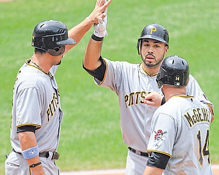 The Pirates' Pedro Alvarez, center, is congratulated by teammates Garrett Jones, left, and Casey McGehee after hitting a threerun home run off Indians starting pitcher Jeanmar Gomez in the fourth inning Sunday.