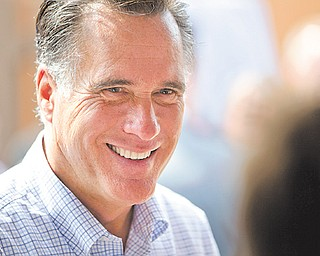 Republican presidential candidate, former Massachusetts Gov. Mitt Romney smiles during a campaign stop at Mapleside Farms on Sunday, June 17, 2012 in Brunswick, Ohio.
