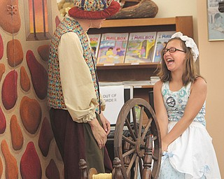 """Jon Kovach of the Madcap Puppet Theatre works with Gabbi Pantaleo, 10, of Boardman, on Monday during a performance of """"Rumpelstiltskin"""" at the Boardman Library."""