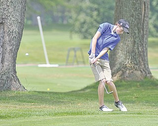 Matt Peck chips out of the rough outside the fairway during the third qualifier for The Greatest Junior Golfer of the Valley tournament Monday at Salem Golf Club in Salem. The top two golfers in each division — boys U-17, girls U-17 and boys U-14 — advanced to the championship set for July 21 at Trumbull County Club.