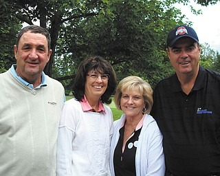 The 19th Annual Golf Outing for Northeast Ohio Adoption Services, which was June 4 at Trumbull Country Club, successfully raised money for NOAS and the Barbara Lewis Roberts Foundation, which supports the mission of the specialized adoption agency. From left are Hank and Sherry Paloci, former area residents who come up each year from Fort Myers, Fla., to form a foursome with Carole and Carter Lewis, right, of Howland, event chairs. This year's outing drew a record turnout of 124 golfers.