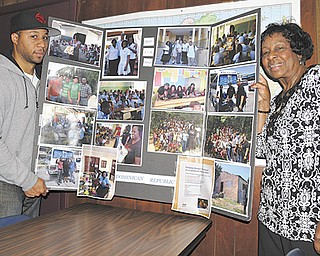 Dr. Doran M. Duke, left, and his mother, Mary Duke, executive director of Teen Straight Talk in Vienna, show off a collage of photos of a recent trip to the Dominican Republic, where they brought several hundred pounds of shoes and clothing to the impoverished people there.