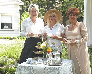 The Holborn Herb Growers Guild Garden Tea Party is scheduled from 2 to 4 p.m. July 8 at Western Reserve Village in the Canfield Fairgrounds (Use Gate 5). Participants can tour the historic buildings, sample herbal teas and delicacies, and enter a hat contest. Features of the day will include demonstrations of herbs and herbs for sale. A teacup and saucer will be available to take home. Children are encouraged to take their favorite doll. Tickets are available by advance sale only. Call 330-718-2013 or 330-533-3802. Tickets are $10 for adults and $5 for children under 10. Preparing for the annual event are, from left to right, Yvonne Ford, Sue Petrollini and Johanne Edel.