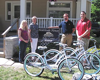 """The Boardman Lions recently donated three 26-inch Huffy Cruiser bicycles and three helmets to the Beatitude House, 287 Lora Ave., Youngstown. The bikes are kept on site and assigned to children there to ride in the neighborhood. The Beatitude House also teaches the new owners about bicycle safety. Pictured left to right are: Anna Grzebieniak, child advocate; Sister Mary Alice Koval, education director; Terry Shears, Boardman Lions president; and Lee Ward, Boardman Lions member. The donation is the latest by the Lions, who have also contributed to the Boardman Township Fire Dept., the Linus Project, Coats for Kids, Fourth-Grade Foresters' Arbor Day Project, landscaping of the """"Welcome to Boardman"""" signs on Route 224 and Market Street, and vision testing and medical visits for those in need who qualify."""
