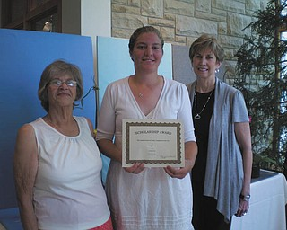 The Garden Forum of the Greater Youngstown Area Inc. presented Emily Conrad, center, of Louisville, Ohio, with a $500 scholarship at the June Flower Show at the Davis Center in Fellows Riverside Gardens. Conrad is a student at Kent State University Salem Branch working toward a bachelor's degree in horticulture. In addition to college, she works at a greenhouse. Also pictured are Mary Schall, left, president, and JoAnn Vlacancich, scholarship chairperson and 3rd vice president.