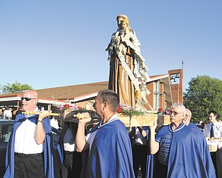 A traditional celebration of the Feast Day of St. Anthony of Padua recently also marked the merger of St. Anthony of Padua and Our Lady of Mount Carmel churches in Youngstown. The event included a Mass, a procession with a statue of St. Anthony, music and food.