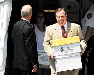Karl Rominger, attorney for former Penn State University assistant football coach Jerry Sandusky, leaves the Centre County Courthouse after the defense rested its case last week. Rominger visited his incarcerated client Monday.