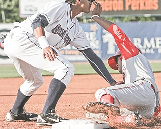 Scrappers third baseman Erik Gonzalez tags out Crosscutters baserunner Chace Numata to complete a fielder's choice in the first inning of Tuesday's game at Eastwood Field. The Scrappers won 6-2.