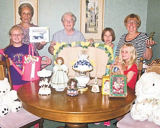 The Ursuline Center will have its annual car trunk and treasure sale from 9 a.m. to 1 p.m. July 14 at the center, 4280 Shields Road, Canfield. Area residents and vendors will sell new and used items in the parking lot. Ursuline Sisters of Youngstown will sell goods inside the center, including a room full of antiques and collectibles for serious shoppers and a large selection of books on contemporary spirituality and classic theology. Preparing the items are, from left, India Gatts, Kay Hartman, Sister Bridget Nolan, Katie Weingaro, Eileen Novotny and Sabrina Gatts. All proceeds benefit the ministries of the sisters at the center. For information or to participate in the outdoor sale, call Novotny at 330-533-3831.