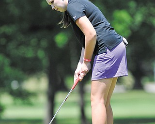 Rosy Hearns watches her putt during her round at Wednesday's qualifier for The Vindicator's Greatest Junior Golfer of the Valley tournament at Tam O'Shanter. Hearns shot a 78 to win the girls' 15-17-year-old division.