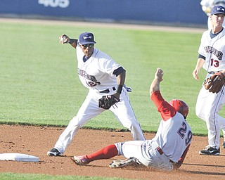 Scrappers shortstop Robel Garcia steps on second and avoids the slide from Crosscutters baserunner Brian Pointer during the first inning of Wednesday's game at Eastwood Field.