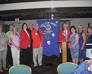 Boardman Lions Club members recently installed a slate of officers for the 2012-2013 season. Accepting the responsibility of their offices were, from left, Terri Wilkes, secretary; John Landers, treasurer; Judy Jones, director; Jaclyn Rausch, director, Ron Paris, first vice president; Bill Rausch, third vice president and tail twister; John Woodside, district governor-elect; Mary Shobel, lion tamer; Laura Hancock, membership; and Patti Shears, director. Also seated but not pictured were Terry Shears, king lion, and Kris Dailey, director.