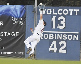 Scrappers right fielder Hunter Jones goes airborne to make a catch and prevent a State College rally during the top of the seventh inning of Thursday's game at Eastwood Field.