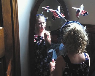 Lilyanah Miller, 3, daughter of Adam Miller and Erica McElroy, gets dressed for the holiday. Photo sent in by Erica McElroy.
