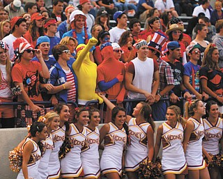 This photo of Mooney cheerleaders and some spirited fans in the crowd behind them came without information.