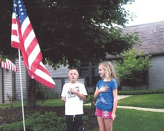 Patty Gordulic of Canfield sent in this photo of her grandchildren, Jarrett and Gianna Gordulic, honoring the flag Memorial Day 2011. Patty said the flag is from the Canfield Rotary and she's proud to fly it.