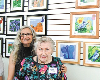 """Donna Galey, front, of The Manor in Austintown, won best of show for her painting """"Birds & Berries,"""" upper right corner. Galey is pictured with Suzanne Gray, YMCA art coordinator."""