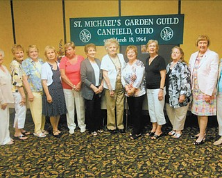 """St. Michael Garden Guild recently hosted its annual flower show and dinner in the parish center, in Canfield. The theme was """"God Bless America."""" Kaye Smith presided, and Sheila Bowman was the judge. Pictured left to right are: Pat Hoyle, Cookie Beeman, Marilyn Chiu, Carol Cartwright, Jeri Bertison, Doe Gallagher, Helen Mocker, Janet Murray, Jane Bolton, Mary Ann Silvestri, Karen Cabraja and Liz Rehlinger. Anita Gorman is not pictured. Silvestri won best in show for arrangements, and Cartwright won best in show for horticulture. Blue ribbon winners for arrangements were Sylvestri, Cartwright, Gallagher, Bertison and Rehlinger. Cabraja, Bertison, Cartwright, Hoyle, Chiu, Beeman, Bolton, Gorman, Mocker and Murray won blue ribbons for horticulture. Beeman was clerk, Smith, Lyon, Rehlinger, Cabraja, Hoyle and Molvin were hostesses."""