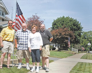 A flag-leasing project is being sponsored by Centenary United Methodist Church in East Palestine. Representatives of the church are David Mollenkopf, who installs flags; Clyde and Michele Hoffmeister, co-chairmen of the flag-leasing committee; and the Rev. Mark McTrusty, pastor.