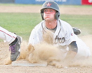 The Astro Falcons' James Coates dives back to the base ahead of the tag by Creekside Fitness first baseman Hank Schlueter in the first inning during Game 2 of the Class B baseball championship Wednesday at Cene Park in Struthers. Astro led Creekside, 3-1, before the game was suspended by lightning in the bottom of the fifth.