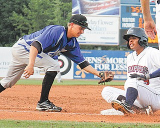 Scrappers baserunner Erik Gonzales slides into third base under the tag by the IronBirds' Anthony Caronia during their New York-Penn League game Wednesday at Eastwood Field in Niles. After a rain delay in the top of the ninth inning, the IronBirds rallied to win, 3-1.