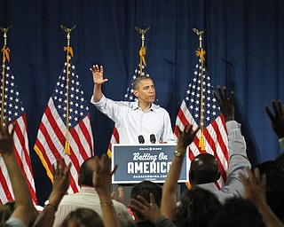 MADELYN P. HASTINGS | THE VINDICATOR..President Barack Obama during his speech at Dobbins Elementary School in Poland, Ohio on July 6, 2012. The crowd puts up four fingers to represent their support of electing Obama for four more years into office. ... - -30-..