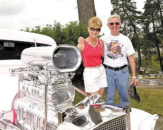 "Kenny and Jeanie Hill stand next to their 1934 Chevy that won best paint job for its ""Cotton Candy Pink"" at the ""Back to the '50s Weekend"" festival in New Castle."
