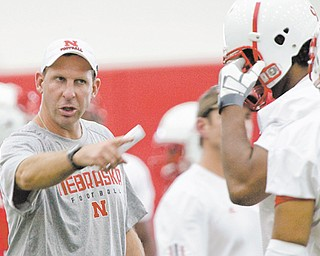 Nebraska head coach Bo Pelini, left, has 16 starters returning from last year's 9-4 team and is excited about his team's prospects this season. He's not as thrilled about college football's new four-team playoff.