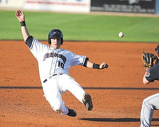 Scrappers baserunner Evan Frazar slides into third base while Connecticut third baseman Tyler Hanover waits to field the ball during Monday's game at Eastwood Field.